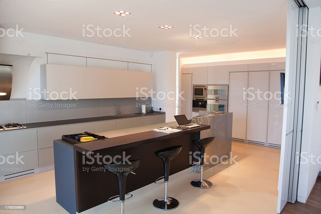 Islands and stools in modern kitchen stock photo