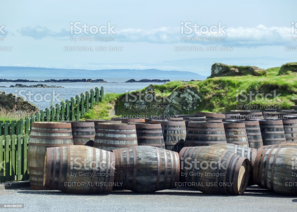 Islay, Scotland - Sseptember 11 2015: The sun shines on Ardbeg distillery warehouse stock photo