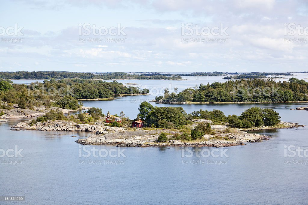 Islets in Stockholm outer Archipelago with small house. stock photo