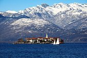 Isola Pescatori at Lake Maggiore surrounded by snowy peaks, Italy