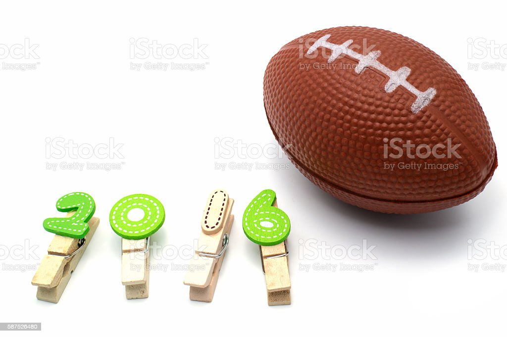 Isolated american football toy and number 2016 on white background. stock photo