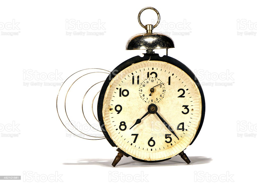 isolated ancient alarm-clock and mainspring stock photo