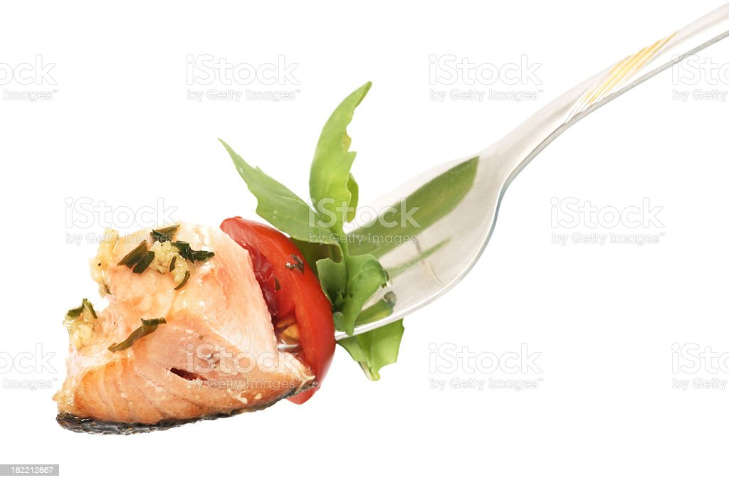 Isolated background of salmon, rucola and tomato on fork royalty-free stock photo