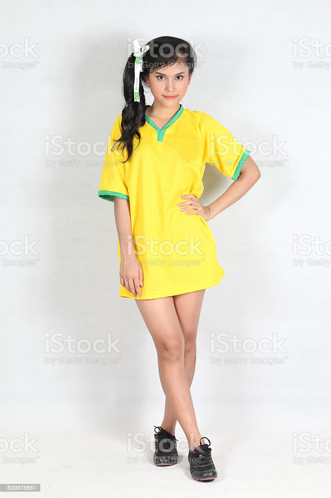 Isolated Beautiful woman with smiling wearing Brazil football to stock photo