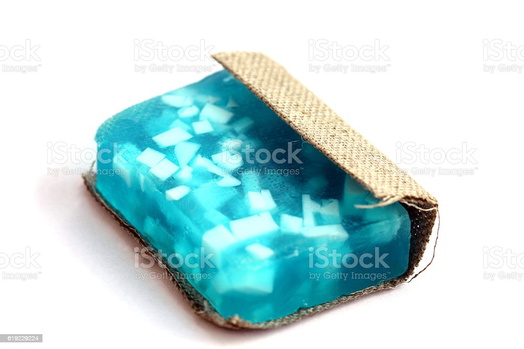 isolated blue bar soap, wraped in cloth stock photo