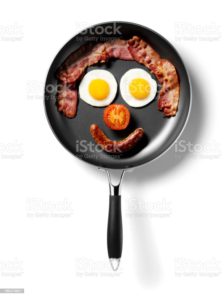 Isolated Breakfast Smily Face in a Frying Pan stock photo