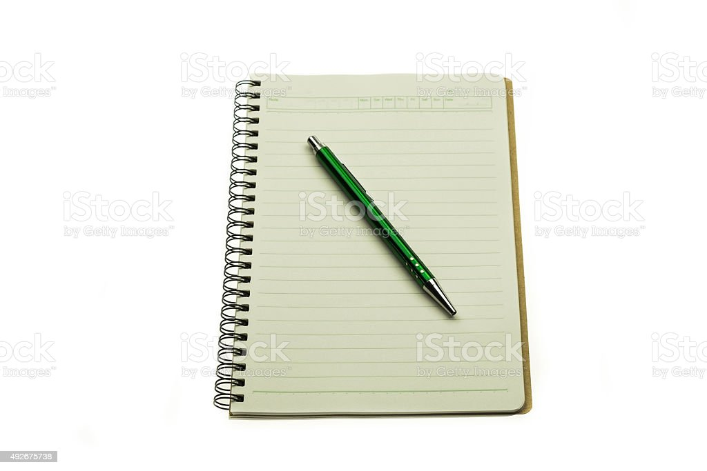 Isolated brown notebook with pen stock photo