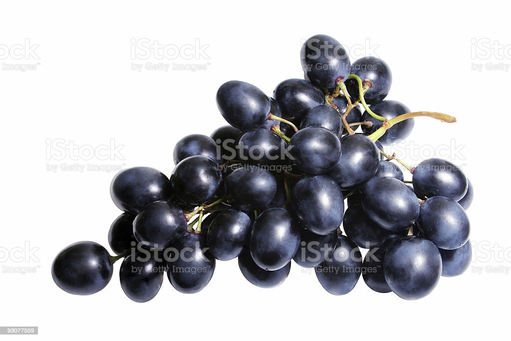 Isolated bunch of black grapes on a white background stock photo