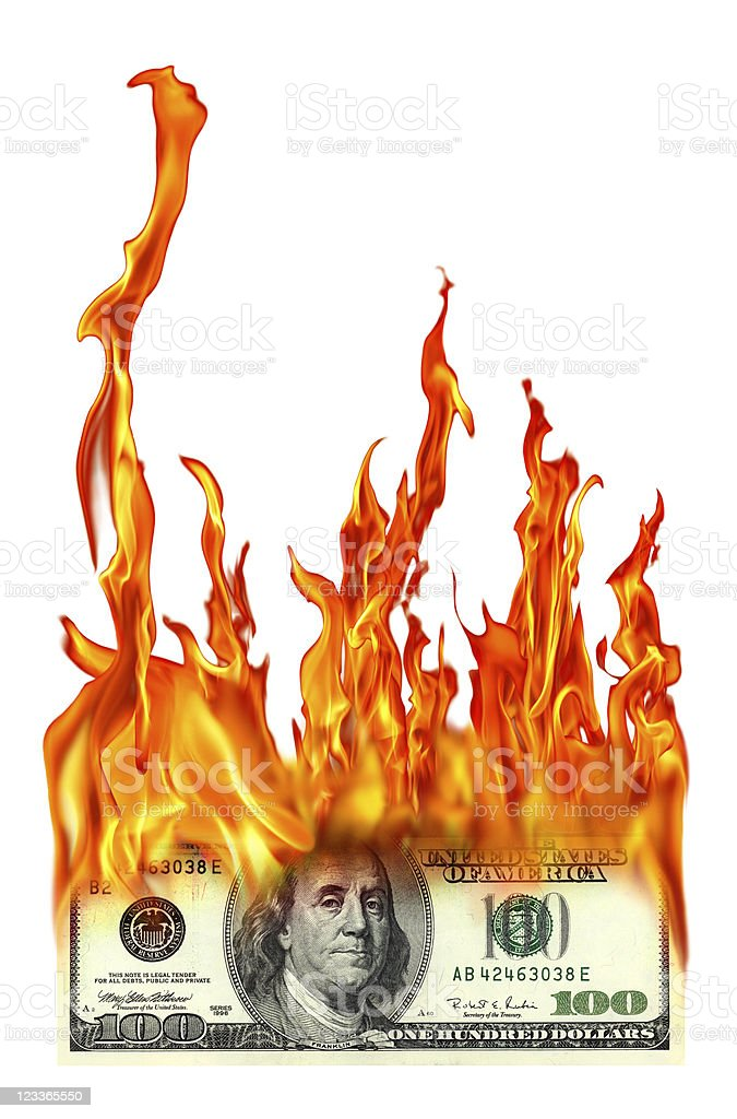 isolated burning one hundred dollar stock photo