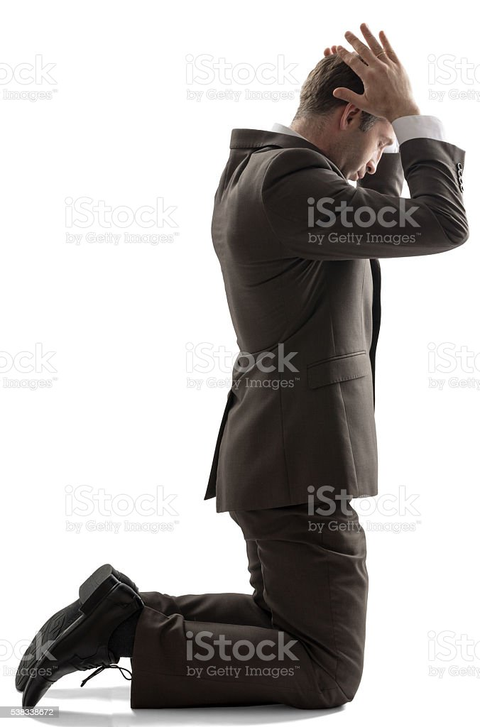 Isolated business man pray position stock photo