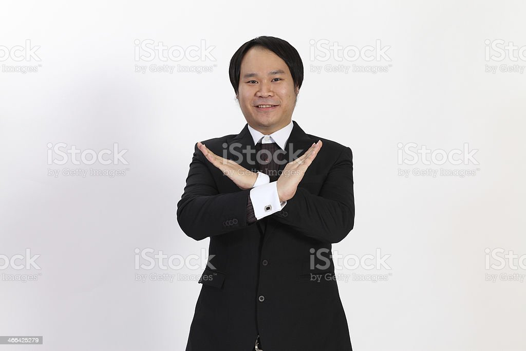 Isolated business man show x symbol on overwhite background stock photo