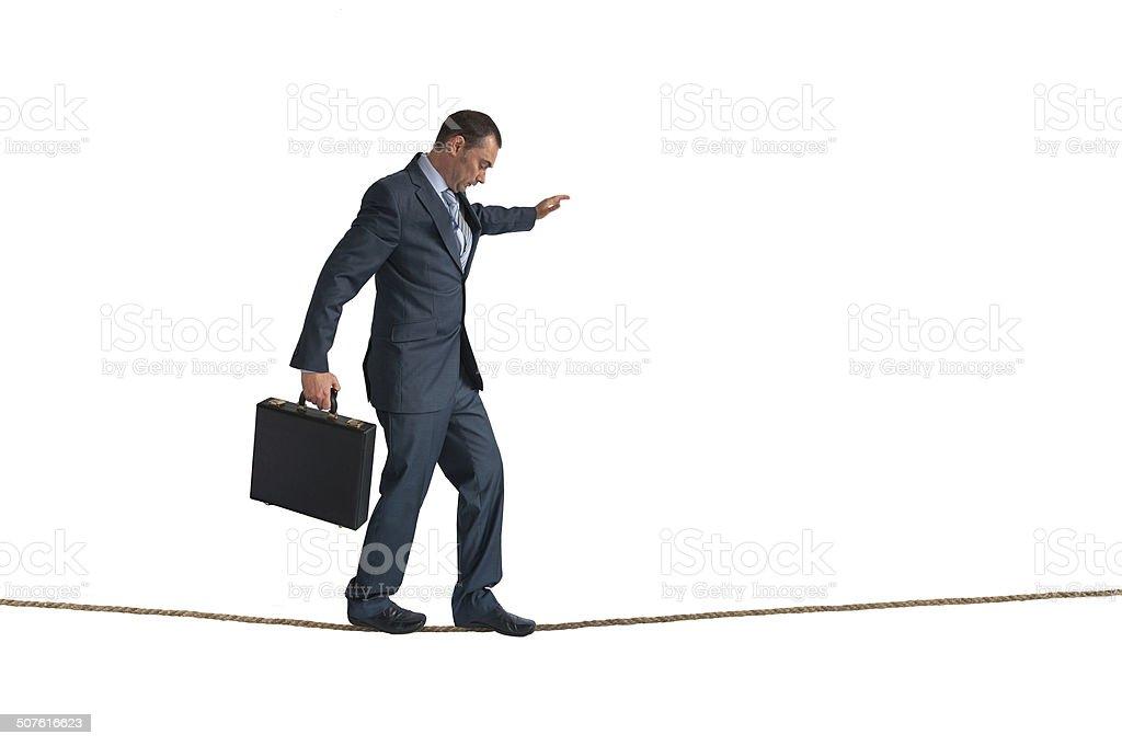 isolated businessman balancing tightrope stock photo
