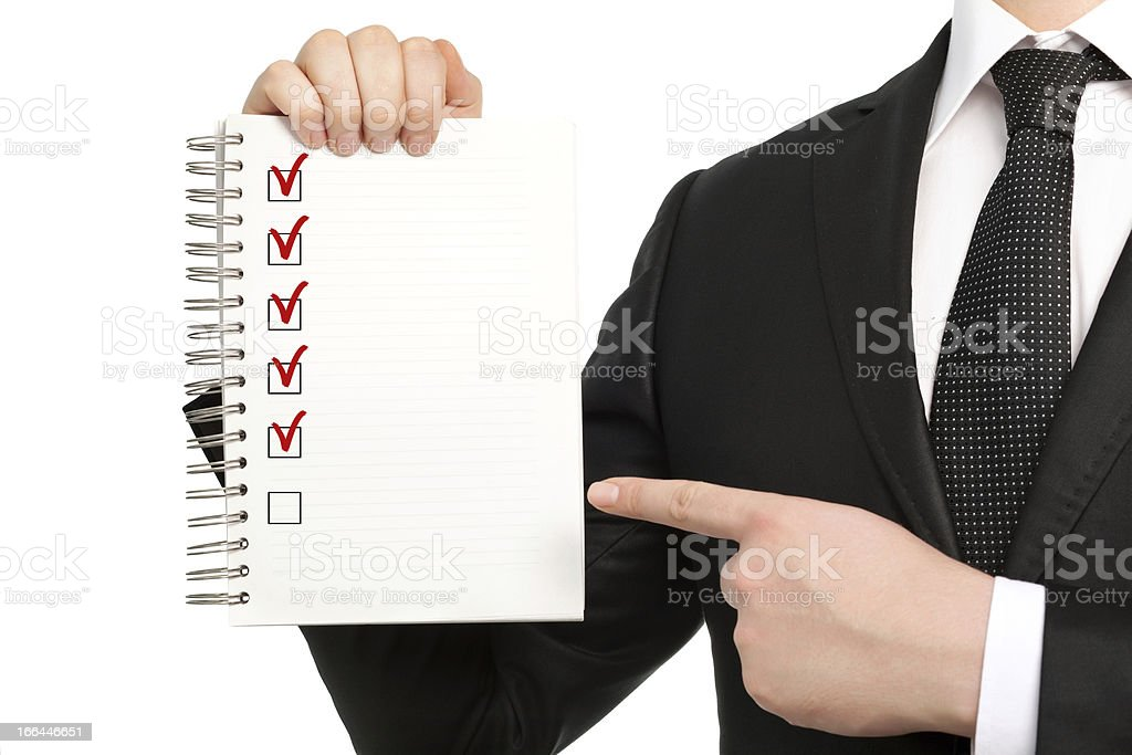 isolated businessman in suit holding notebook or piece of paper royalty-free stock photo