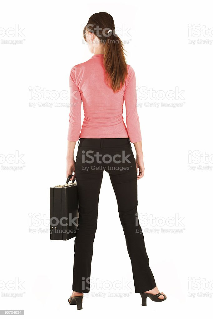 Isolated businesswoman shot from behind royalty-free stock photo