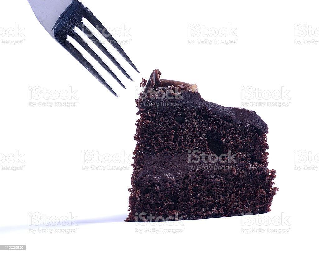 isolated cake being eaten with  fork stock photo