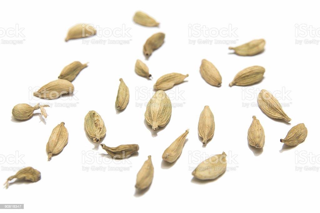 isolated cardamom seeds royalty-free stock photo