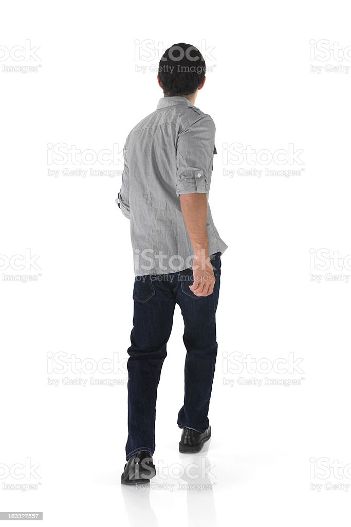 Isolated casual man walking away rear view stock photo