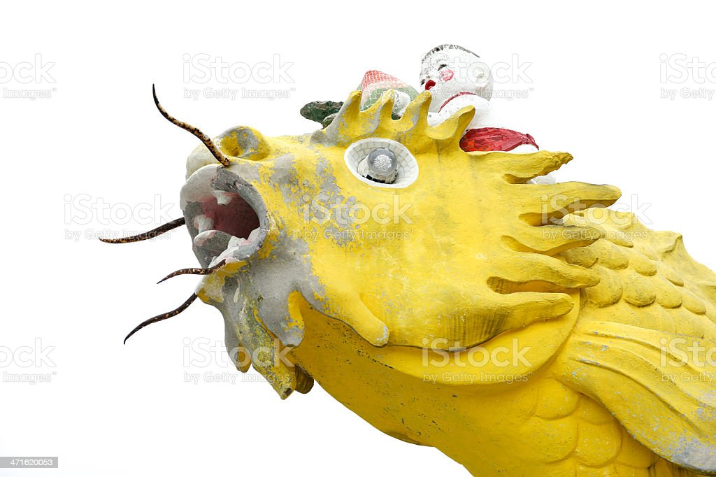 Isolated Chinese baby god riding on a fish statue royalty-free stock photo