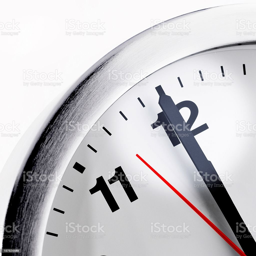 isolated clock just before deadline royalty-free stock photo