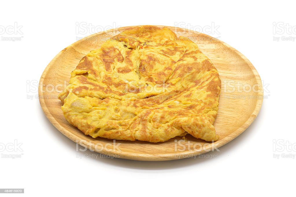 Isolated close up omelet on wooden dish stock photo