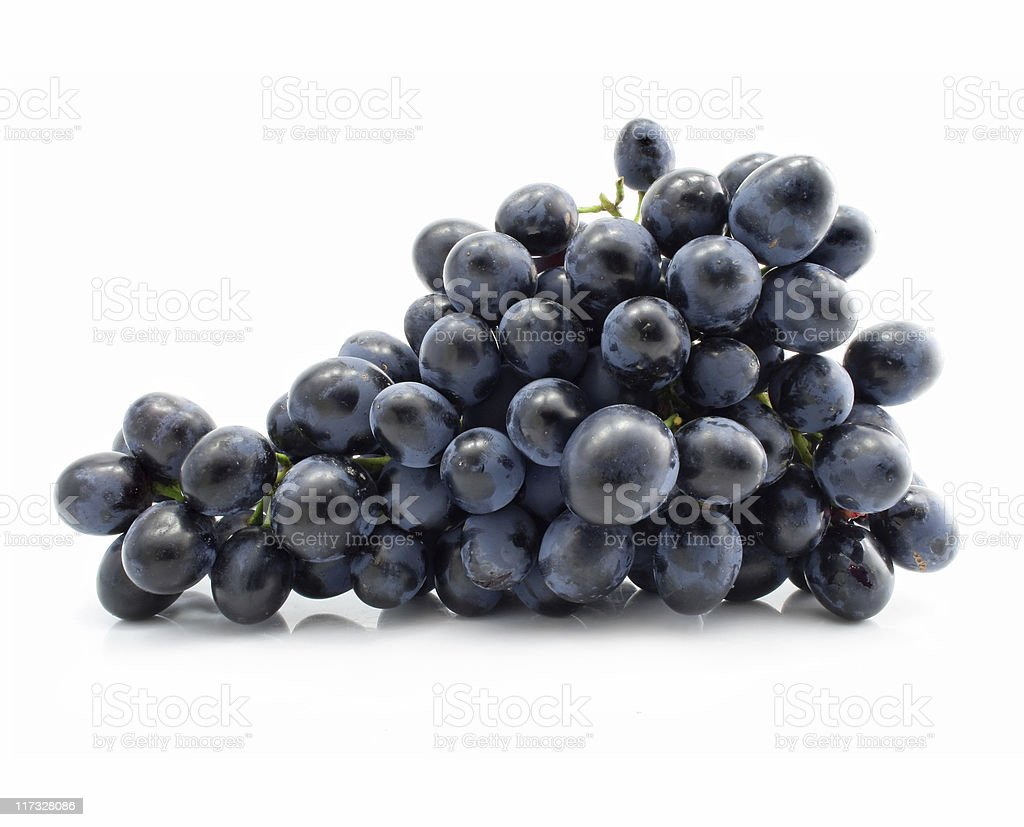Isolated cluster of blue grapes stock photo