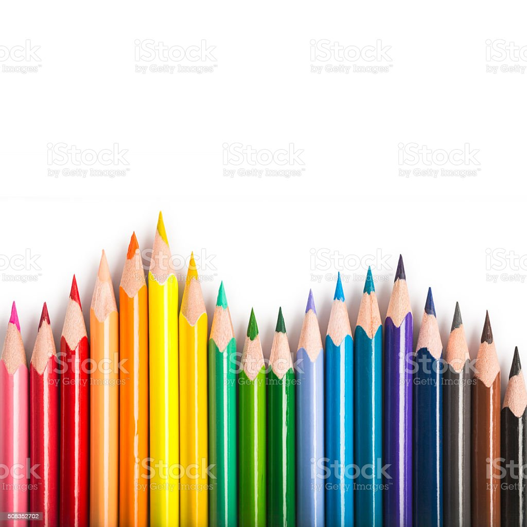 Isolated colored pencil forming a rainbow stock photo
