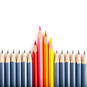 Isolated colored pencil standing out from the crowd