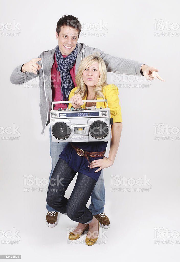 Isolated couple rocking out with a boom box stock photo