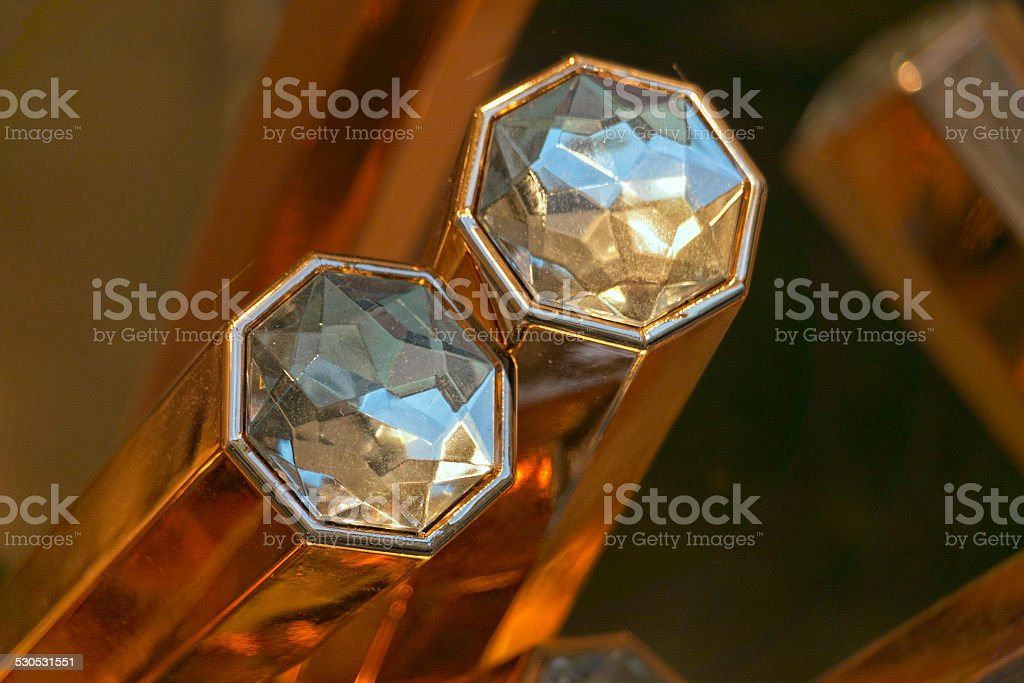 isolated diamond on gold bar stock photo
