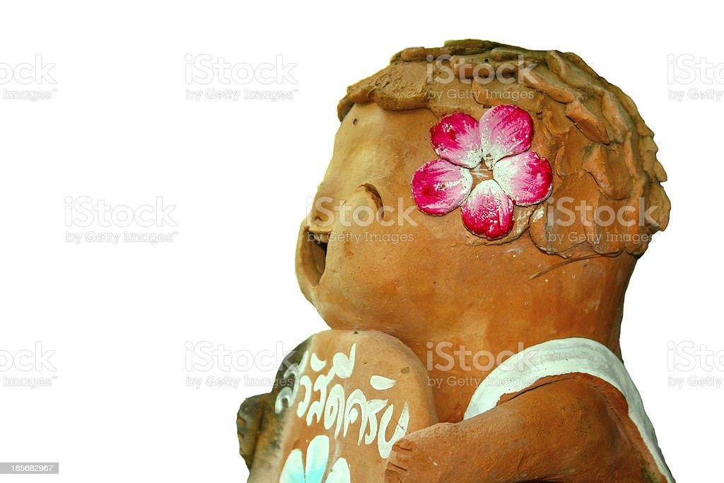 Isolated Earthenware doll stock photo