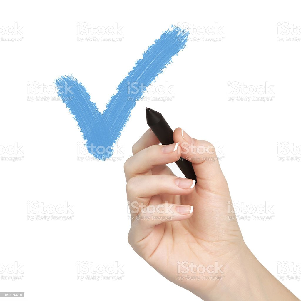 isolated female hand with pencil draws the tick royalty-free stock photo