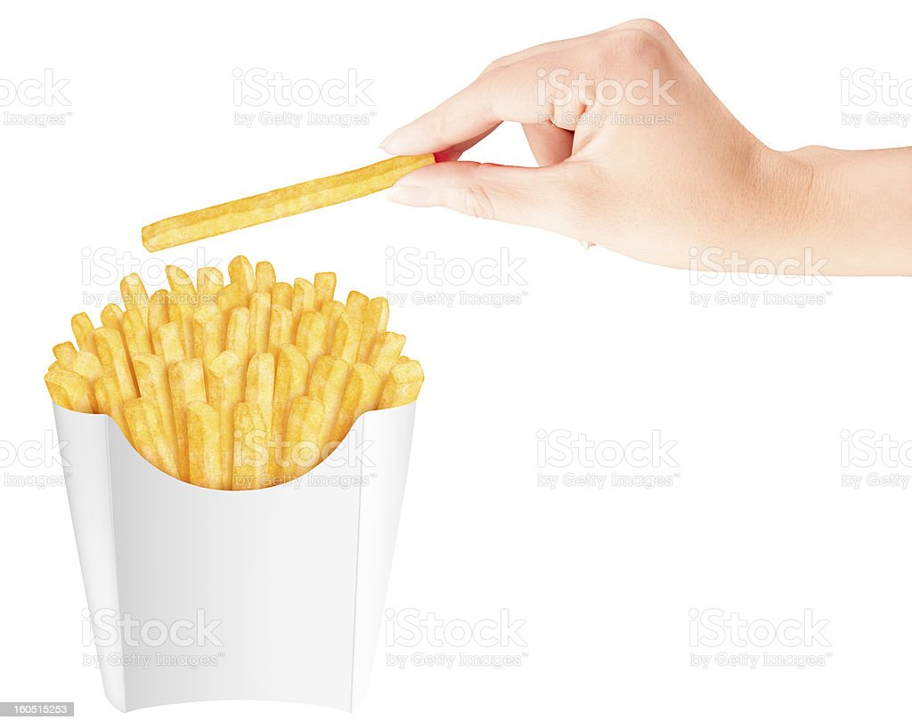 Isolated french fries in packaging with hand holding one fry stock photo