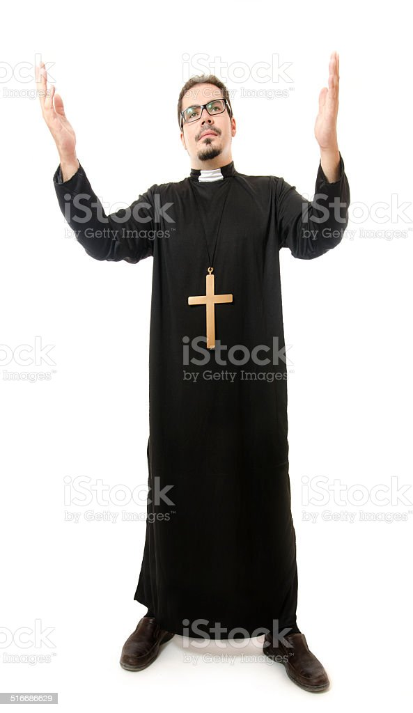 Isolated full priest on white background stock photo
