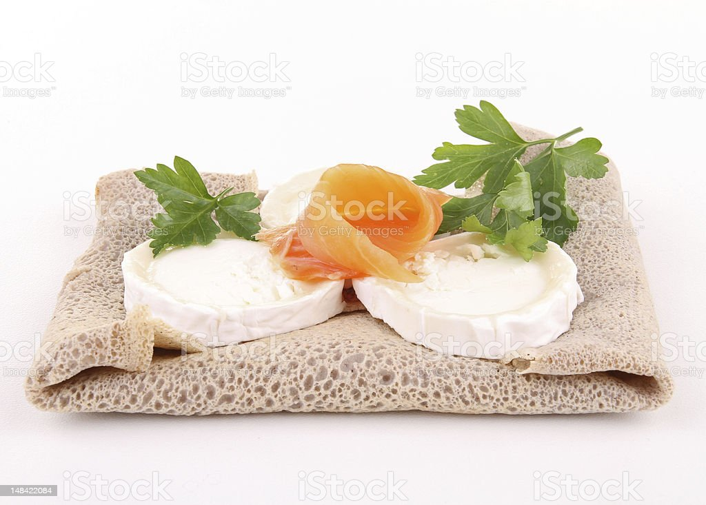 isolated galette with cheese and salmon stock photo