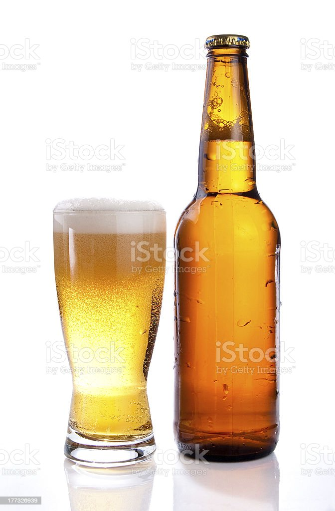 Isolated Glass and Brown bottle of beer on white background royalty-free stock photo