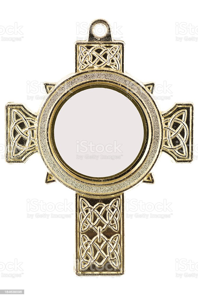 Isolated gold medal shaped like an Irish cross royalty-free stock photo