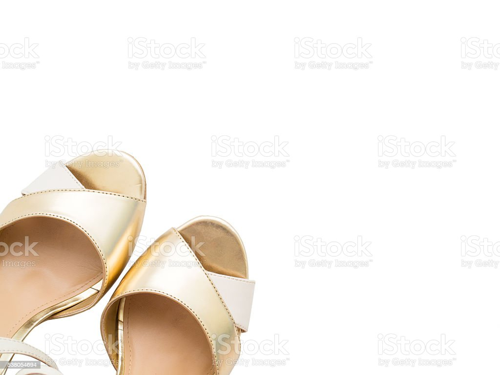Isolated gold woman shoes stock photo