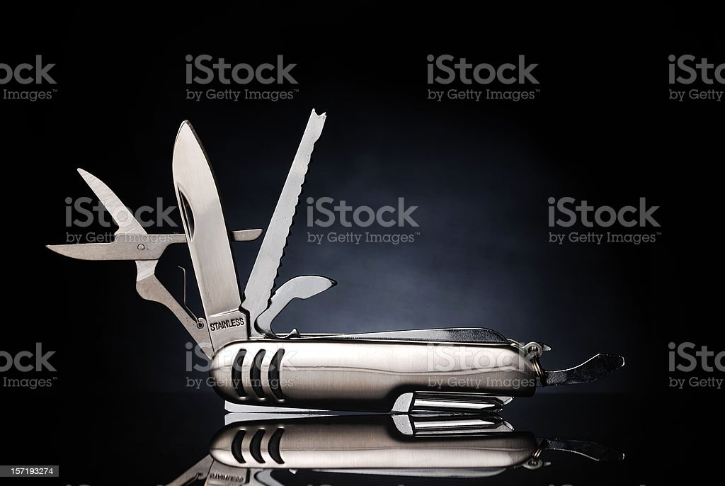 Isolated gray pocket knife with its tools extended stock photo