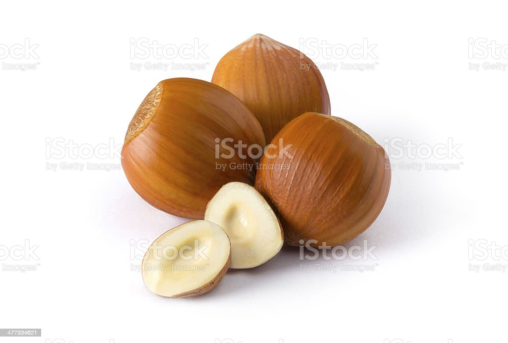 Isolated group of hazelnuts on white background royalty-free stock photo