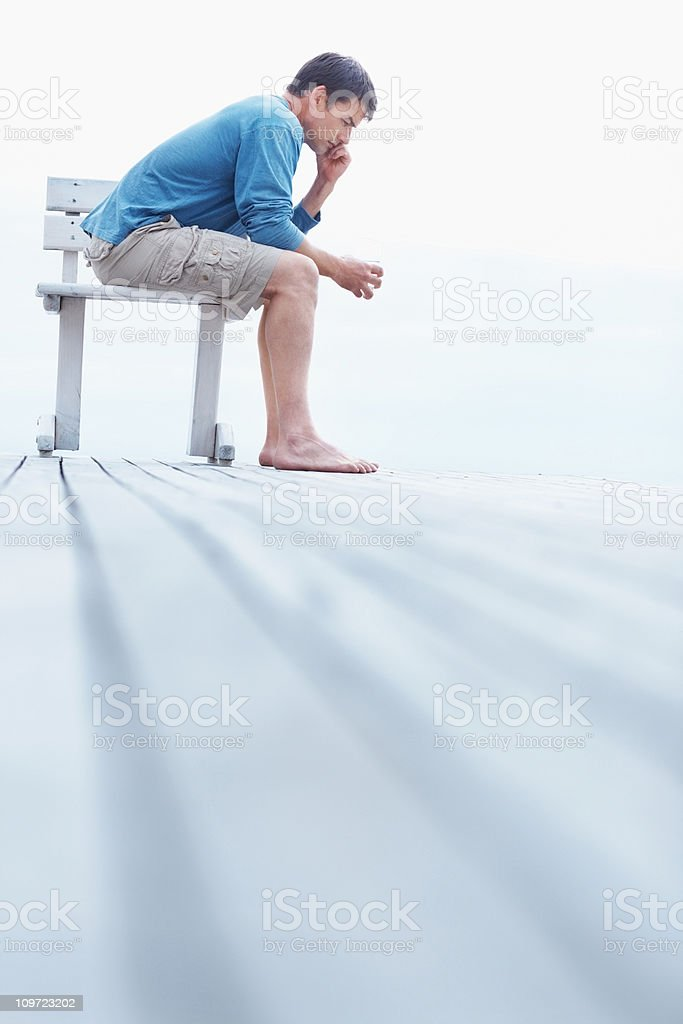 Isolated guy talking on a cellphone while sitting down royalty-free stock photo