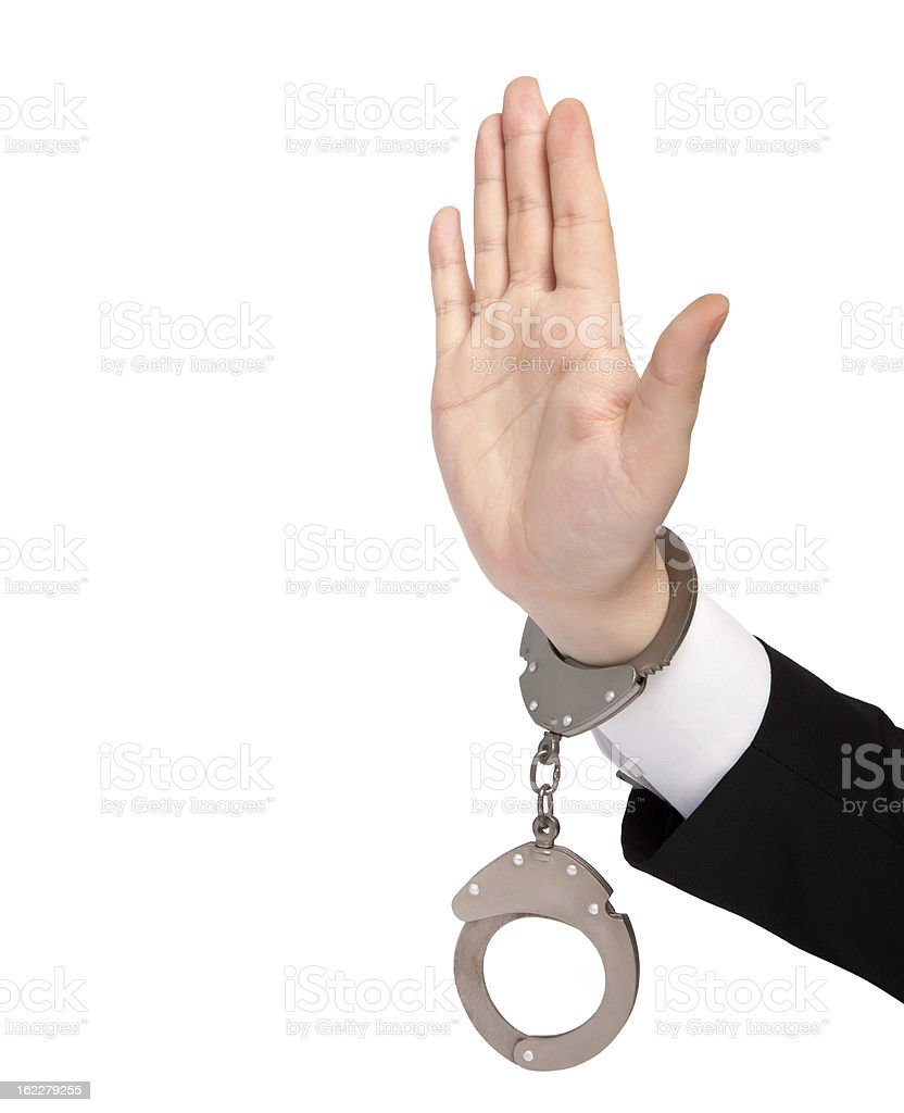 isolated hand of a businessman in handcuffs shows stop royalty-free stock photo
