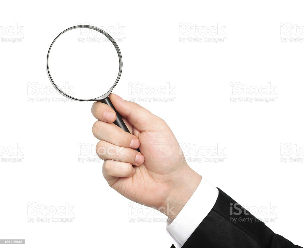 isolated hand of businessman in suit holding a magnifying glas royalty-free stock photo