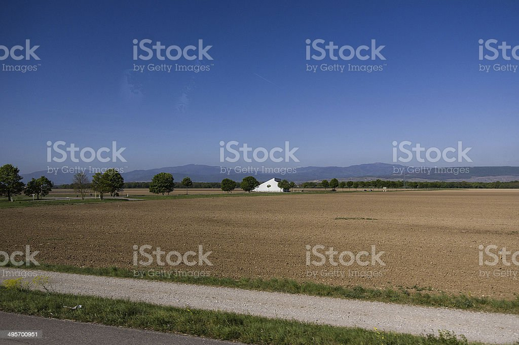 Isolated house in a cultivated field stock photo