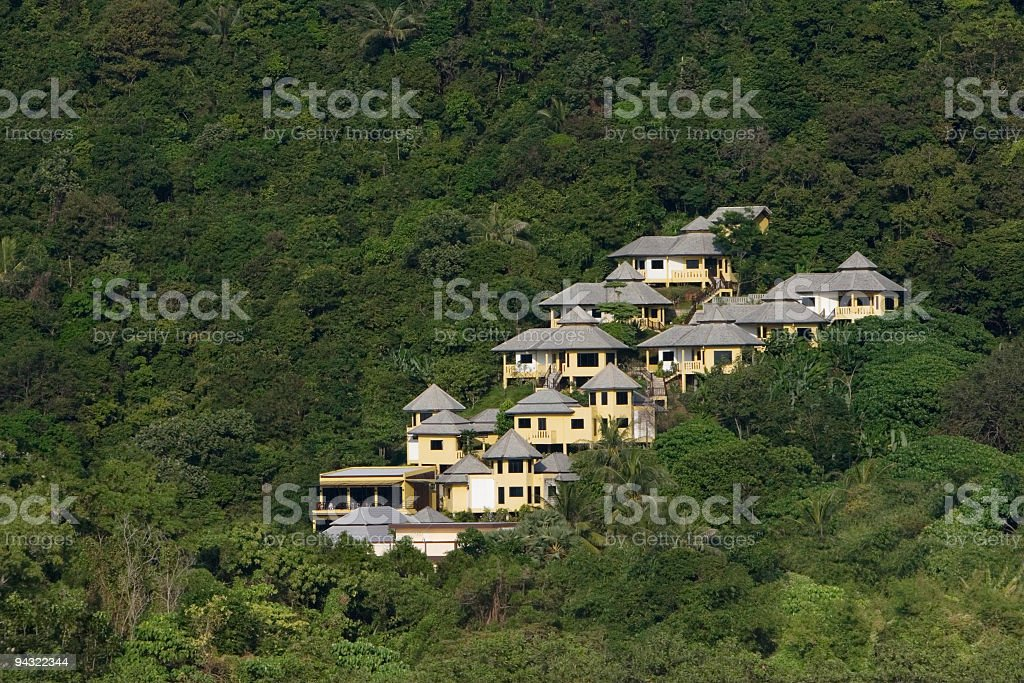 Isolated house in the mountains stock photo