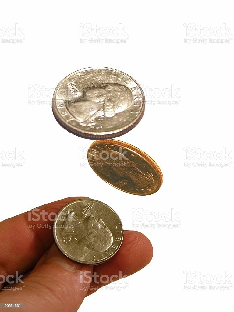 Isolated image of a coin being tossed in the air stock photo