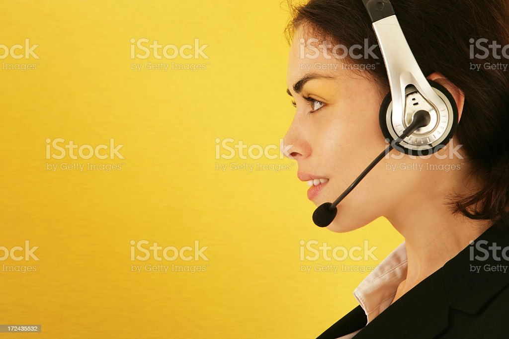 Isolated image of a girl using her headset on yellow royalty-free stock photo