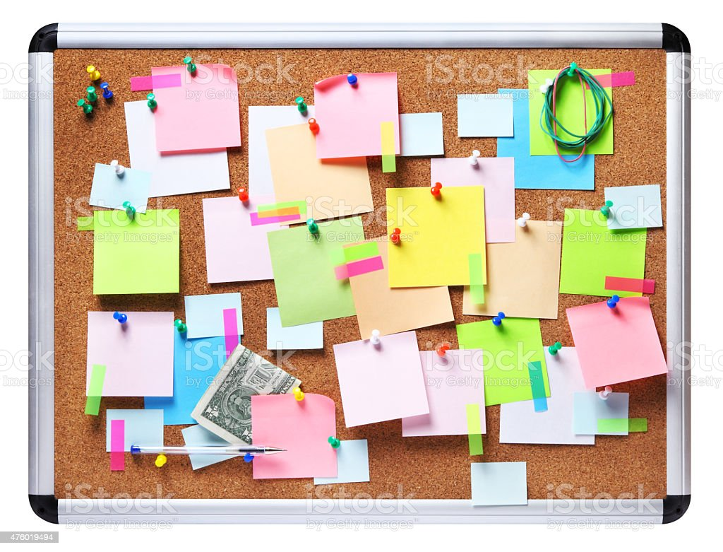 Isolated image of colorful sticky notes on cork bulletin board stock photo
