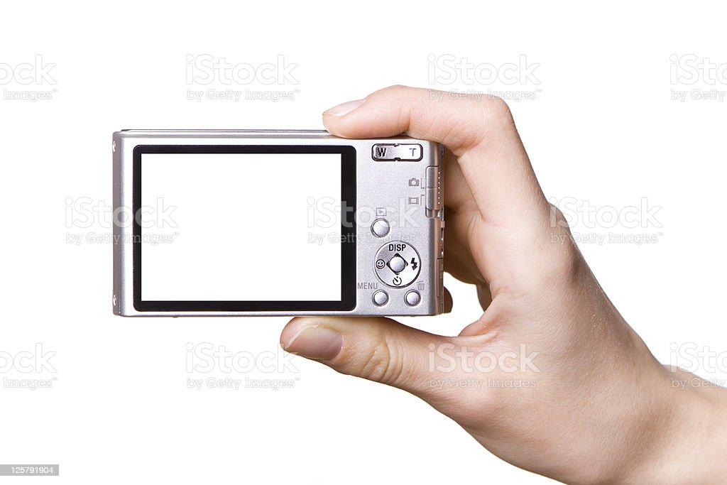 Isolated image of hand holding digital camera royalty-free stock photo