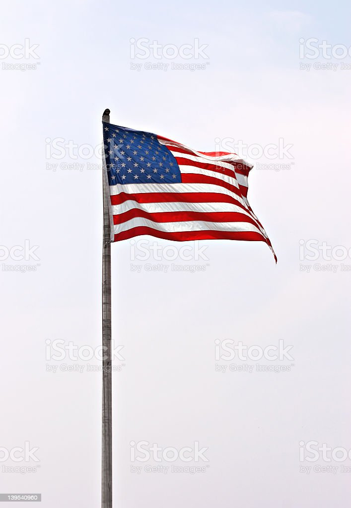 Isolated image of the American Flag on a cloudy day stock photo