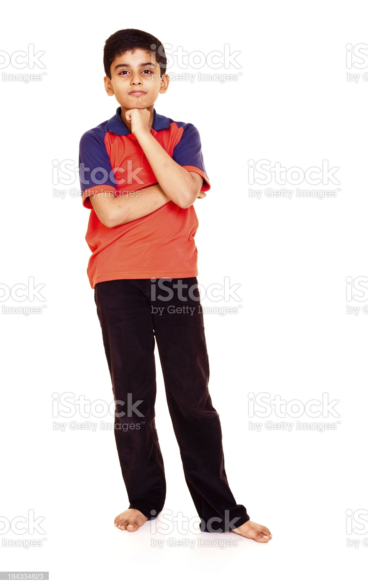 Isolated Indian Boy Standing Pensive Hand on Chin Full Length royalty-free stock photo